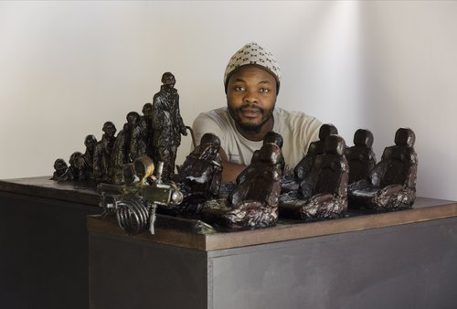 Lwandiso Njara with his work